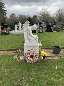An Angel Headstone with Bowed Head